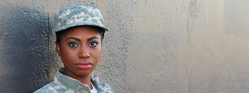 veteran female leaning against wall